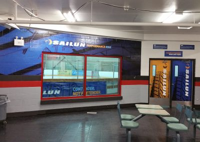 Full Lobby Shot - Wall Graphic - Rink Sign - Access Doors INT